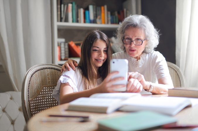 photo-of-woman-showing-her-cellphone-to-her-grandmother-3768140 by Andrea Piacquadio