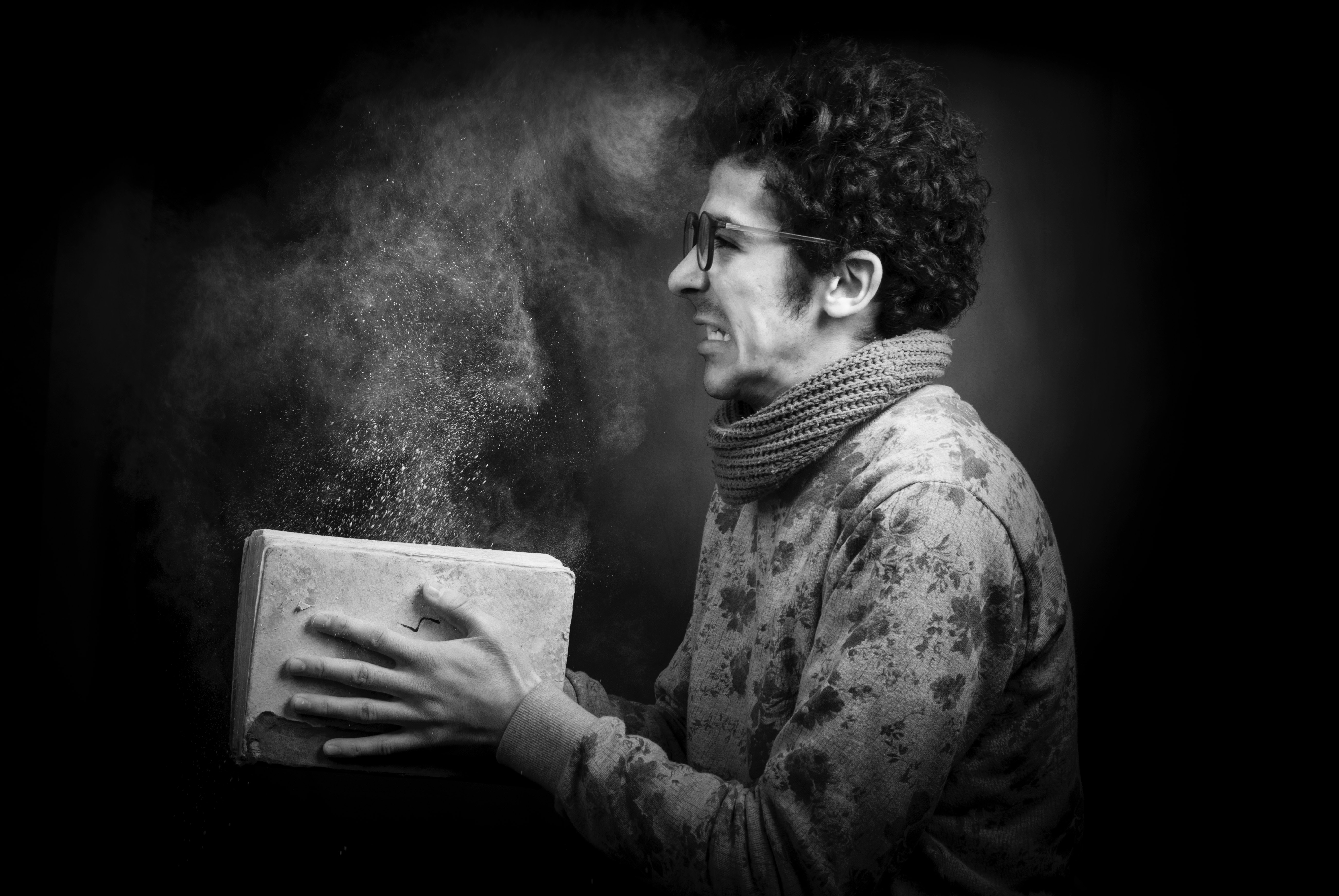 grayscale-photo-of-a-man-wearing-sweater- by mohamed Abdelgaffar